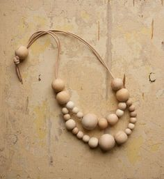 Nice wooden bead and leather necklace.