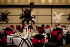 Red & black chair covers, black & white linens, feather centerpieces.  Photography (mangostudios.com).  See more of Nicole's wedding - http://www.canadianbride.com/articles/nicole-barclay--sean-salmon