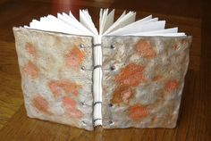 faux hammered and pitted metal (polymer clay) and coptic bound blank book