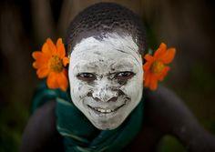 Surma boy with flowers - Ethiopia by Eric Lafforgue, via Flickr