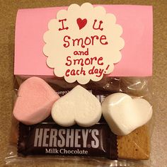 heart shaped marshmallows  mini Hershey bars  a graham cracker  and a baggie!  Cute, simple, and sweet.