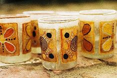 Glass votive holders with tea bag art. (It's possible the company in south africa is no longer around.)