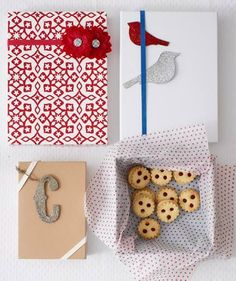 Use a wide rubber band to secure a box of cookies, then attach an ornament or present topper or slide a cheerful embellishment underneath.