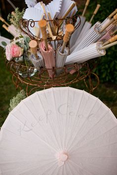 summer gardens, vintage weddings, sunny days, amber, umbrella, southern weddings, baskets, flowers, entrance