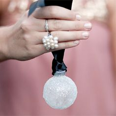 The perfect winter wedding favor: icy snowball ornaments!  We could make them with the monogram and hang them on our tree centerpieces.  Then the guests can take them off and take home when they leave!