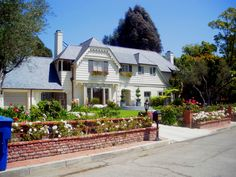 Beverly Hills home reflecting window flower boxes and street side / tree lawn flower planters.