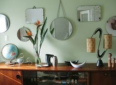 Old mirrors are a steal at garage sales and thrift stores. Pick one up to add light and instant glamour to any space.