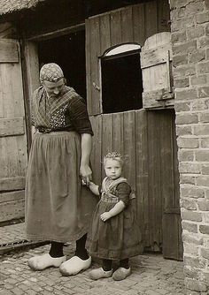 1965: Mother and daughter from the 'oldfashioned' Dutch village Staphorst, still in black & white.