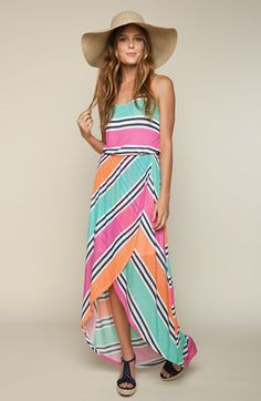 The perfect getaway look: Maxi dress, floppy hat, & wedge sandals