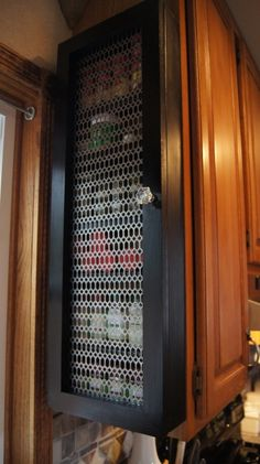 Out of space for spices? Attach DIY dedicated storage to the outside of your cabinets. spice cabinet, diy spice, cabinet doors, medicine cabinets, kitchen, spice storage, spice racks