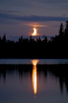 **Moon setting on the lake Garden Hill, Manitoba - Canada