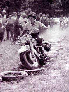 ~MOTORCYCLE 74: 1950's-Woman riding Harley  through obstacle course--Riding skills---You go, girl!