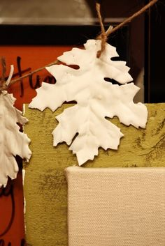 DIY maple leaf garland. Coat silk maple or oak leaves (or any type of leaf) in plaster, let dry, tie to jute twine. Pretty Thanksgiving decorations.