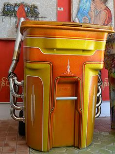 Oh to have the most beautiful trash can in the neighborhood... that's not my thing.  This is cool though.  What do you think?