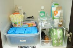 Organizing Under the Bathroom Sink via MrsJanuary.com #organized #bathroom