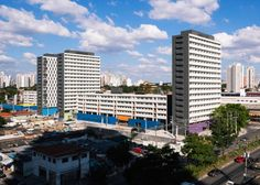 Brazilian studios MMBB and H+F Arquitetos reference tower blocks from the 1960s with this social housing complex flanking the Octávio Frias de Oliveira Bridge in São Paulo.