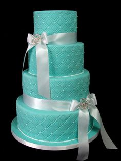 Turquoise wedding cake with simple white ribbons #wedding #weddingcake #cake #turquoisewedding #somethingblue