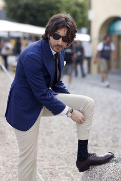 polka dot patterns on his shirt and socks
