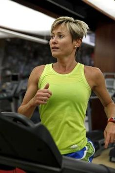 Gina Garcia, assistant fitness director at SMU, starts her work out with a 15- minute warmup on the treadmill at the university's Dedman Center.