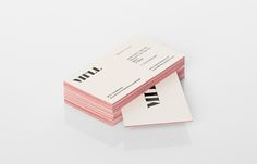 Logo and business card with red edge painted detail designed by Anagrama for architecture and landscaping firm MTLL