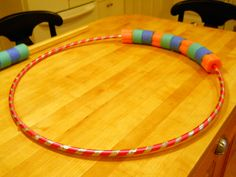 "Kinder-Gardening:  I made a larger version of a number bracelet using a hula hoop and pool noodles that I cut into ""beads."" This is also handy when decomposing numbers. You can add or take off as many beads as you need!"