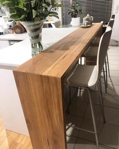 We created this Blackbutt kitchen island to extend an existing kitchen space. X