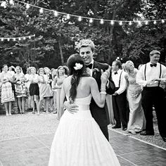 """""""Caroline and Clark have their first dance on the dance floor illuminated by simple, inexpensive white lights hung from the trees."""" Excerpt taken from Southern Living's Garden-Inspired Wedding."""