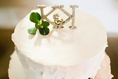 glittered initial cake topper // photo by Julie Harmsen // http://ruffledblog.com/seattle-summer-wedding