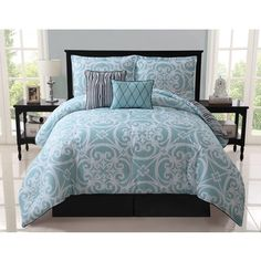 @Overstock.com.com - Kennedy 5-piece Reversible Blue Comforter Set - Turn bedroom space into an inviting cocoon of luxury and style with this chic and sophisticated machine washable set in a vibrant pattern of blues. The item's reverse features unique lines of bold black.  http://www.overstock.com/Bedding-Bath/Kennedy-5-piece-Reversible-Blue-Comforter-Set/8372901/product.html?CID=214117 $79.99