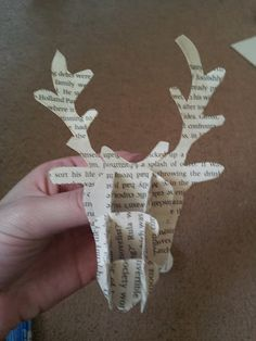 book page stag tree decoration tutorial Thinking I would do this with the sheet music to Rudolph the Red Nosed Reindeer and add a nose,