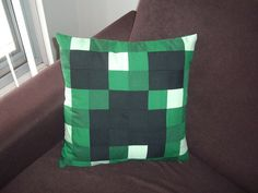 Minecraft Creeper pillow - This is $25.00 on Etsy but I think it could be made a lot cuter.