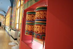 Spin a prayer wheel to send a prayer or a wish up to the heavens.