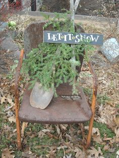 Prim Winter...old rusty chair with shovel, pine, & sign.