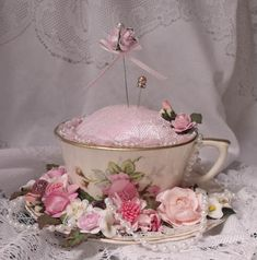 What a sweet pincushion and if the cup is glued to the saucer, a place to put pins when removing them.