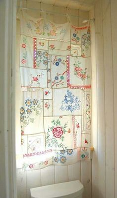Curtain of vintage hankies - I wonder if I could do this with all my grandmas sweet handkerchiefs.