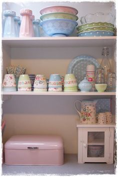 I want some of those flowered dishes on the middle shelf.  Where to find them...
