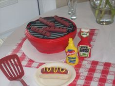 HOT DOG GRILL GROOM'S CAKE, by www.LuLusSweetExpectations.com (mustard, ketchup, hotdogs, buns, plate, ALL made of fondant and rice cereal treats, grill is chocolate cake with buttercream. chocol cake, rice cereal, hot dog, hotdog, groom cake, cereal treats, grill cake, chocolate cakes, dog grill