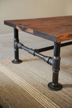 {plumbing supplies and old planks = rustic industrial style coffee table.}