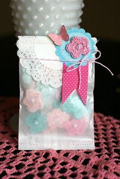 Crochet flowers in pretty packaging.