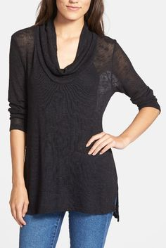 Tunic tops paired with jeans and a pair of awesome heels for a night out.