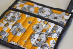 Pretty Potholders | Prudent Baby.  Square quilted design, with pocket