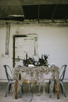 mossy tablescape, photo by Rach Lea Photography http://rufflebdlog.com/halloween-oddities-inspiration-shoot #tablescapes #weddingideas
