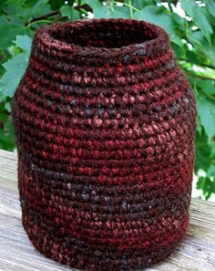 This earth tone crochet vase (free pattern) was made by crocheting two strands of yarn onto a 22-gauge floral wire!