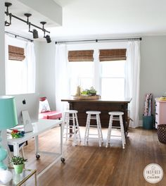 Color on the walls with dark bar and natural shades. Love this whole house! Paint color is SW Aloof Gray