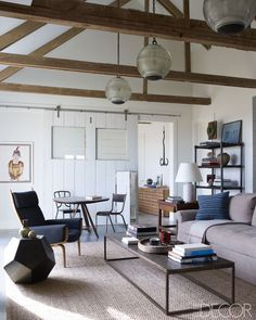 French light fix­tures + vintage decor in Hamptons cottage by Robert Stilin Interiors via elle decor