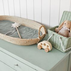 Olli Ella Reva Baby Changing Basket and Sage Luxe Organic Cotton Liner | Natural Rattan | Nursery Inspiration  available at Jut & Juul Lifestyle for kids, Leiden NL