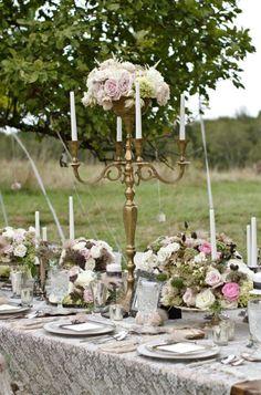 Bronze Candelabra Centerpiece - awesome way to incorporate flowers into a candelabra centerpiece.