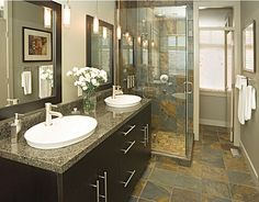 example of combining different stone looks with dark cabinets.