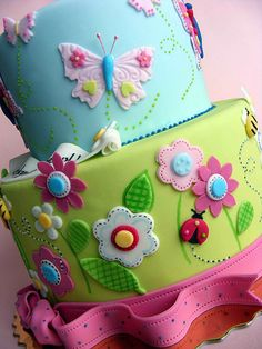 Flowers and butterflies cake  love it @Riana Slone Slone Reynolds