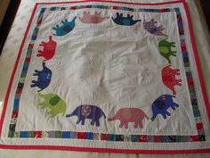 elephant quilt, finished by kleio's belly, via Flickr